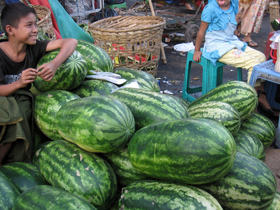 A boy hawks his family's watermelons at a streetside market in Yangon, Myanmar (Burma)