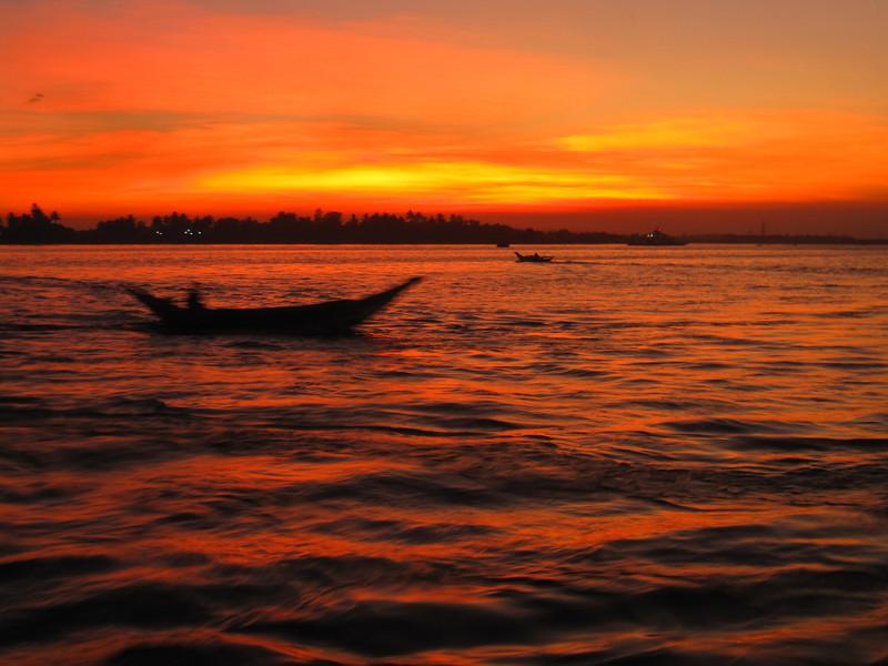 Boats at sunset in Yangon, Myanmar (Burma)