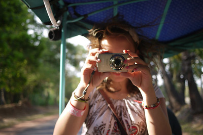 Taking a picture in the back of a tuk-tuk on the way see the temples in Angkor Wat.