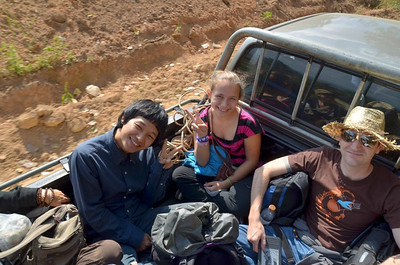Ana, Lee, and Sean in the back of a pickup truck as we make our final leg of the trip up the mountainside outside of Chiang Rai, Thailand.