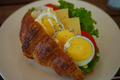Egg and croissant sandwich.