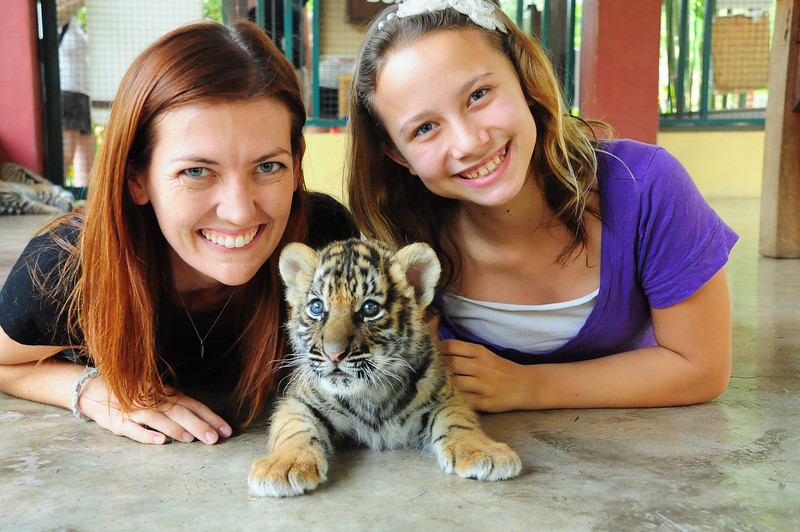 My aunt and I at Tiger Kingdom with a baby tiger.
