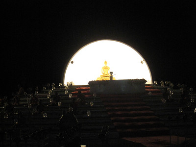 Monks chanting in front of Buddah.