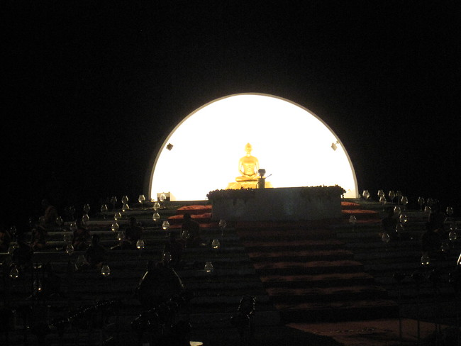 Monks chanting in front of Buddha.