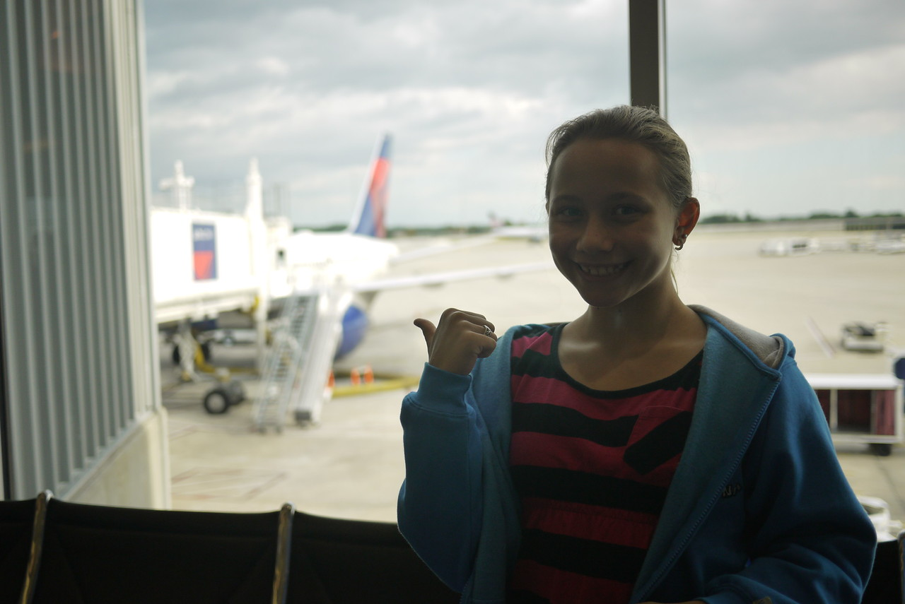 Me at the airport, excited to go on my first airplane/flight.