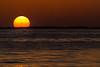 Solen synker i havet