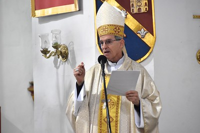 The bishop gives the homily