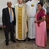 With his parents and the bishop