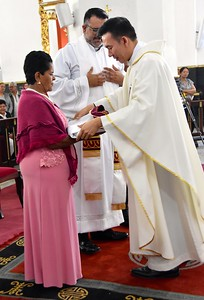 Fr. Vien assists with the vesting