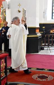 Fr. Tim carries the Gospel