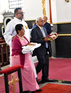 Fr. Juancho enters with his parents