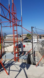 At Cardenas site, Ceaser cleans the roof.