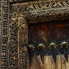 "In Stone Town, Zanzibar, the merchants ""advertised"" with the carvings on their doors. Even though slavery and the ivory trade were made illegal, the chain and tusk carvings incorporated into the door indicate that one could purchase both here."