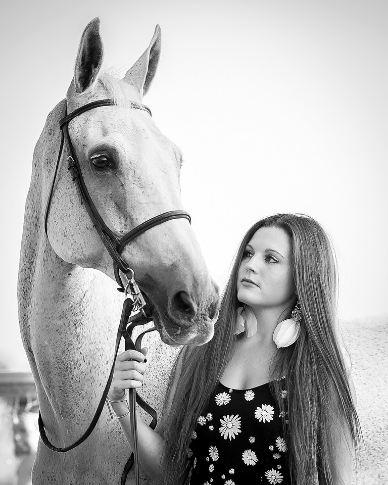 Julie Ward is fabulous! She just did my daughter's Senior pictures, and truly showed her love for photography! Her patience and professionalism is impeccable! She is excellent working with horses as well! <br /> <br /> - Rhonda and April Fisher