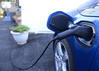 Tania Barricklo-Daily Freemasn  The family's Chevy Volt sits in their driveway plugged in to charge its battery.