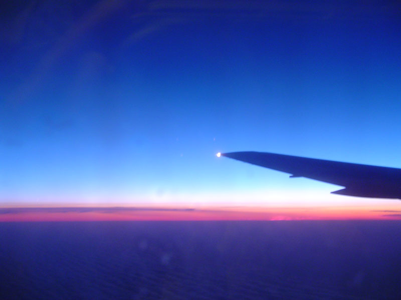 I snapped this intersting photo out the window of our plane as we flew over the Atlantic. The sun never went down completely.