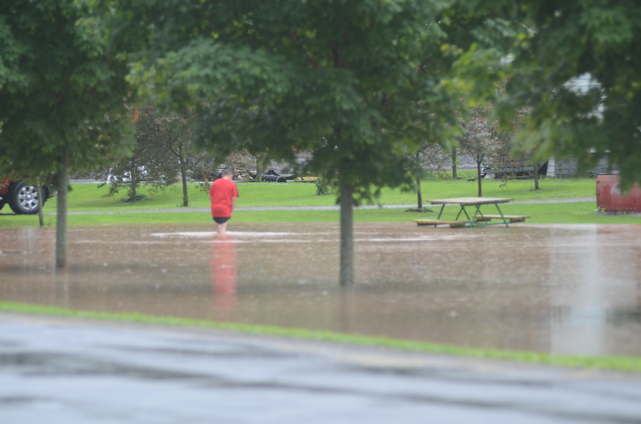 John Brewer - Oneida Daily Dispatch A man stands in flood waters at a Lenox home on Saturday, July 1, 2017.