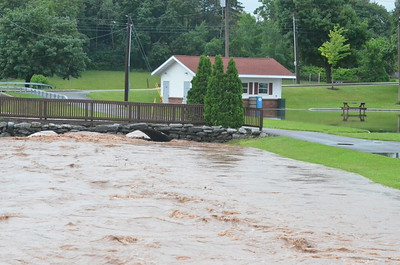 John Brewer - Oneida Daily Dispatch Taylor Creek overflows its banks near the Sherrill City Hall on Saturday, July 1, 2017.