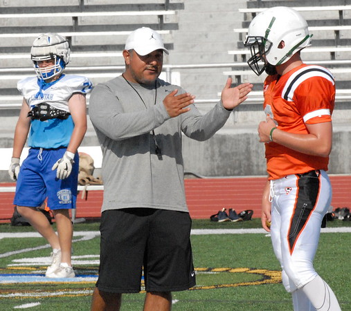 MIKE KAYS/Muskogee Phoenix<br /> Sallisaw head coach Randon Lowe, a former Muskogee offensive coordinator and University of North Texas assistant under former Rougher Seth Littrell, gives direction to his players during Muskogee's three-day team camp at Indian Bowl on Wednesday.