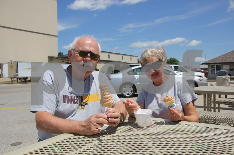 Thursday, July 14, 2016, found several people out enjoying the nice weather. (Left to right)John and Gloria Biegler take time out to have their picture taken while enjoying some ice cream at Netties in Fort Dodge. They were from out of town.