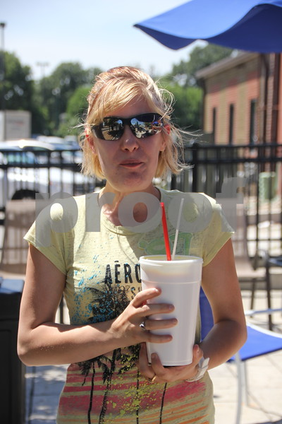 Thursday, July 14, 2016, found several people out enjoying the nice weather. Shown enjoying some ice cream at the Dariette in Fort Dodge is Clarissa Heinen.