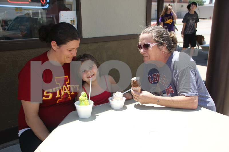 Thursday, July 14, 2016, found several people out enjoying the nice weather. (Left to right) Ashley Klinger, Athena Eslick, and Sherry Stevens took time out to have their picture taken while enjoying some ice cream at Netties in Fort Dodge.