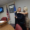 KENTON BROOKS/Muskogee Phoenix<br /> New municipal court judge Lisa Garcia, left, gets help with her robe from Wagoner Deputy City Clerk Alicia Bierman after Garcia was confirmed for the job by the Wagoner City Council this past week.