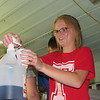 CATHY SPAULDING/Muskogee Phoenix<br /> Gracie Jamison prepares a snow cone inside Shorty, a bus Timothy Baptist Church uses for outreach into the community. Jamison helped serve snow cones at Timothy's Independence Day celebration.