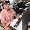 Cathy Spaulding/Muskogee Phoenix<br /> Larry Cragg keeps records of service orders at a Muskogee tractor dealership. He also finds time to fish and be involved with Bedouin Shrine.