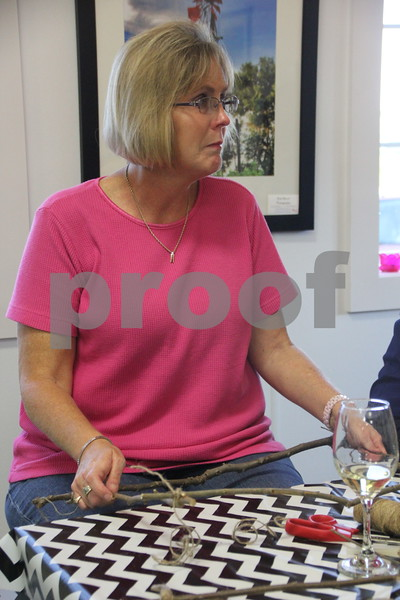 Seen here  making her craft project is Terri Valline. Soldiers Creek Winery held  the Un'Wine'd craft night event on Thursday, July 16, 2015 where she was a participant.