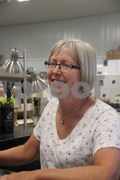 Tammi Secor, owner,  of Soldiers Creek Winery looks on as the ladies take part in the craft night held there on Thursday, July 16, 2015.