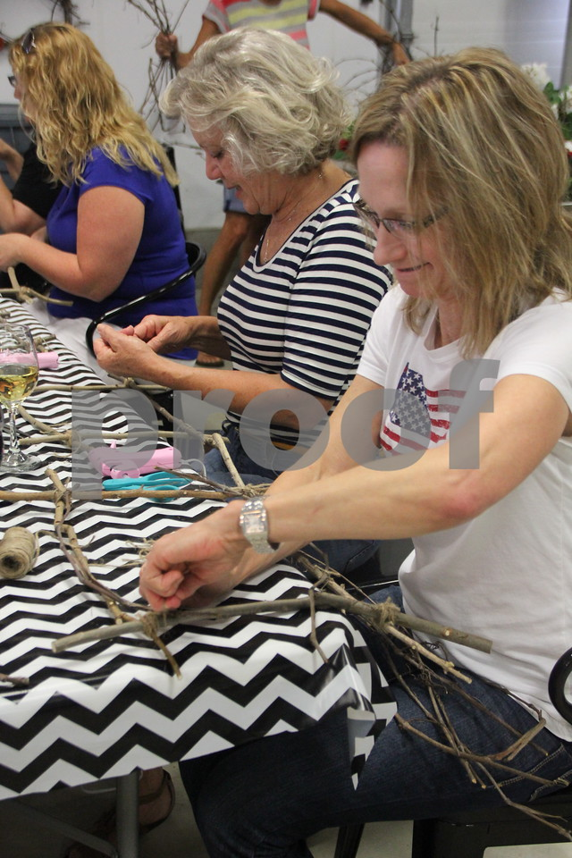 Right to left is: Sandra Batcheller and Jan Moeller as they put together  their prospective craft projects being made at the Soldiers Creek Winery's Un'Wine'd craft night held there on Thursday, July 16, 2015.