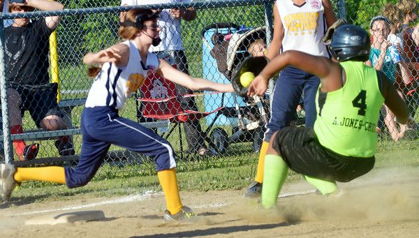 WARREN DILLAWAY / Star Beacon ANGIE CAMENSKY (left) of Conneaut prepares to tag Aungea Jones-Cruz of Ashtabula on Thursday evening during minor league all-star action at Cederquist Park in Ashtabula.