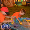Anthony Mette, 3, and Colten Harrington, 2, rifle through the EDN's duck pond after dark. The two were junior members of Jansen's Spud Club team.