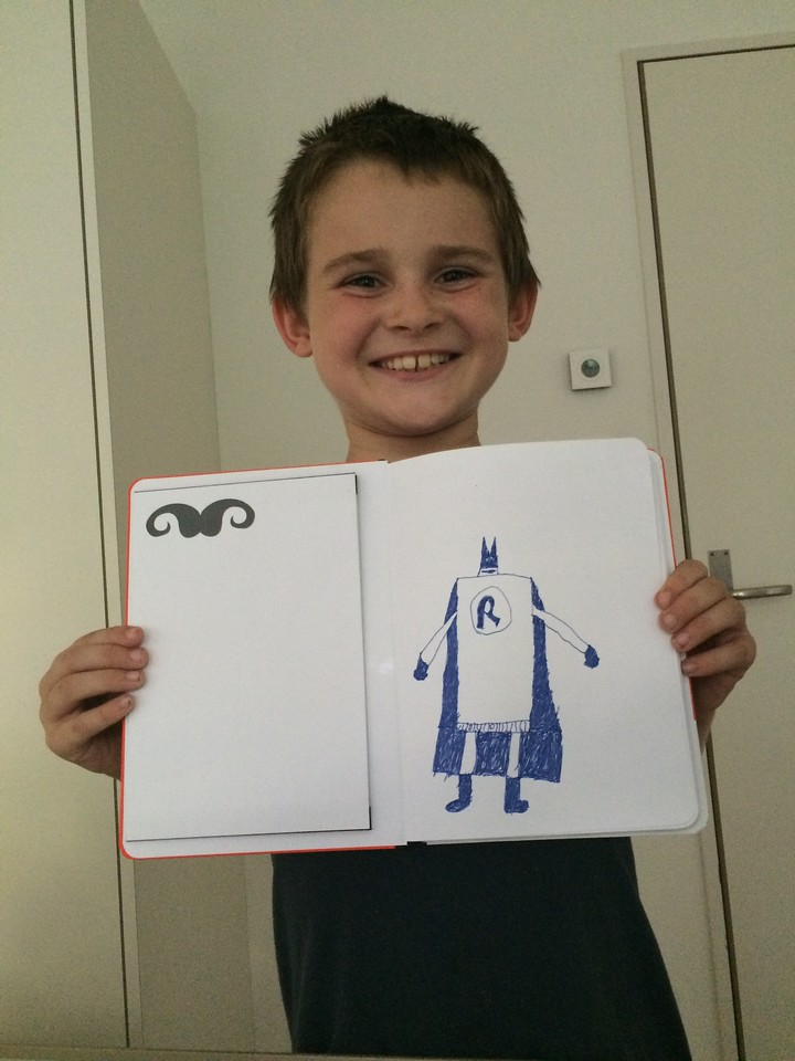 001 Loving his New Drawing Book