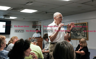 071816  Wesley Bunnell | Staff  John Sokolowski held a meeting on Tilcon's proposed quarry and resorvoir at the Southington Library on Monday evening. Many in attendance are not in favor of the proposals. New Britain resident Martin DiNep helping to clarify audience member questions with John Sokolowski at the podium.