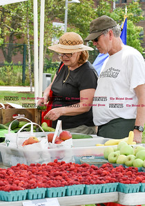 071816  Wesley Bunnell | Staff  Governor Dannel Malloy visited the downtown New Britain CT fastrak station which features a farmers market on Monday afternoons. Sharon Straka & Robert Srulowitz of New Britain stopped by the Dondero Orchard table.