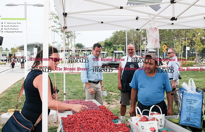 071816  Wesley Bunnell | Staff  Governor Dannel Malloy visited the downtown New Britain CT fastrak station which features a farmers market on Monday afternoons.  Governor Malloy in the walks behind the tent run by Dondero Orchards as customers pick out fresh produce.