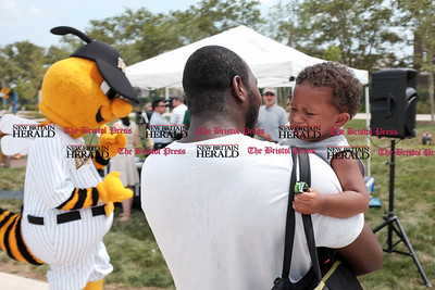 071816  Wesley Bunnell | Staff  Governor Dannel Malloy visited the downtown New Britain CT fastrak station which features a farmers market on Monday afternoons.  A young attendee just after meeting the New Britain Bees mascot Sting.