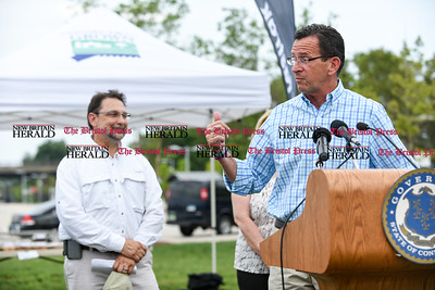 071816  Wesley Bunnell | Staff  Governor Dannel Malloy visited the downtown New Britain CT fastrak station which features a farmers market on Monday afternoons. Governor Dannel Malloy referring to the tent housing tables of fresh produce by Dondero Farms.