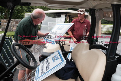 071816  Wesley Bunnell | Staff  The Greater New Britain Chamber of Commerce held their annual golf tournament on Monday at Stanley Golf Course. Course Ranger Bill Boughton wipes down sponsor signs after the end of a lightening and rain delay.