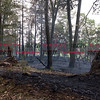 072216  Wesley Bunnell | Staff<br /> <br /> A brush fire broke out on Caretaker Rd in Southington on Monday afternoon. Firefighters from Southington, New Britain & Berlin responded. A 100' x 600' section smoldering on the west side of Caretaker Rd.