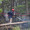 072216  Wesley Bunnell | Staff<br /> <br /> A brush fire broke out on Caretaker Rd in Southington on Monday afternoon. Firefighters from Southington, New Britain & Berlin responded.  Southington firefighters tackle the smoldering 100' x 600' section on the west side of Caretaker Rd.