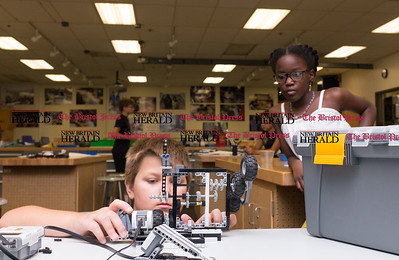 072616  Wesley Bunnell | Staff  From L Griffin Pelletier checks the design on a joint project along with partner Nishtha Polycarpe. Area elementary school students studied Lego/VEX IQ robotics in a weeklong program at CCSU on Tuesday July 26th.
