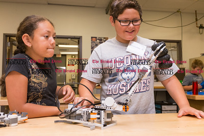 072616  Wesley Bunnell | Staff  Aymara Soler, left, with Nicholas Cordone testing their robotic arm design. Area elementary school students studied Lego/VEX IQ robotics in a weeklong program at CCSU on Tuesday July 26th.