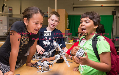 072616  Wesley Bunnell | Staff  Aymara Soler, left, with Nathan Feinberg, middle, laugh when testing out their drop the microphone mechanical arm. Area elementary school students studied Lego/VEX IQ robotics in a weeklong program at CCSU on Tuesday July 26th.
