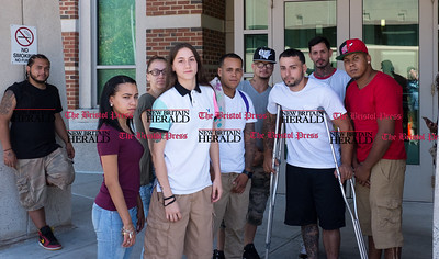 072616  Wesley Bunnell   Staff  Milton Figueroa was arranged in New Britain Superior Court on Tuesday July 26th for his role in a shooting at Newbrite Plaza early Sunday. Fourth from the left is Marimar Larkin, Figueroa's sister, Roberto Alicea on crutches and family and friends.