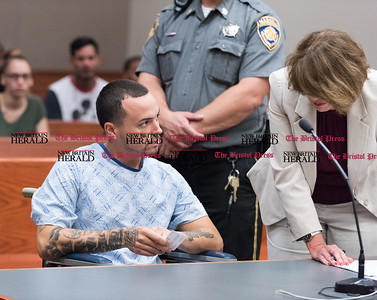 072616  Wesley Bunnell | Staff  Milton Figueroa was arranged in New Britain Superior Court on Tuesday July 26th for his role in a shooting at Newbrite Plaza early Sunday. Figueroa is shown with his attorney Kelly Goulet-Case.