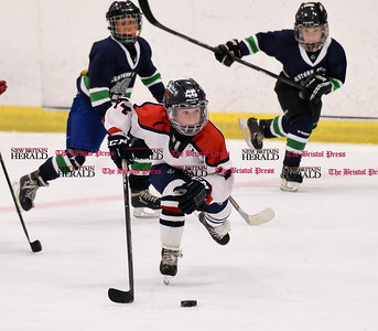 072616  Wesley Bunnell | Staff  The Nutmeg Games held the opening games for 10U boys hockey on Tuesday July 26th. The Central CT Capitals played the Western Mass Bulldogs. Mikita Atsian #44 looks down ice.