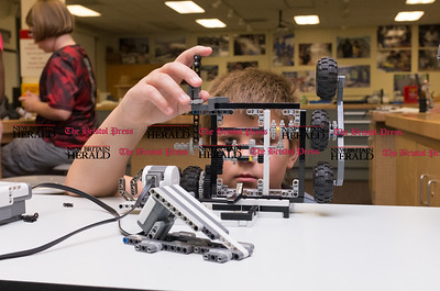 072616  Wesley Bunnell | Staff  Griffin Pelletier checking the design on a robotics project.  Area elementary school students studied Lego/VEX IQ robotics in a weeklong program at CCSU on Tuesday July 26th.